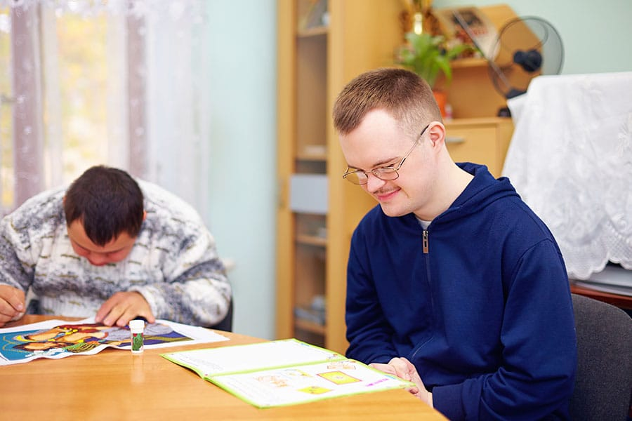 young adult man engages in self study in rehabilitation center