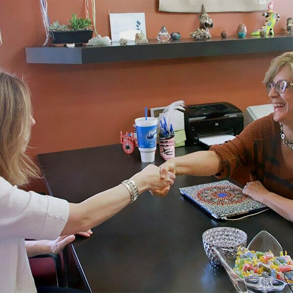 Susan Sandys shaking a clients hand
